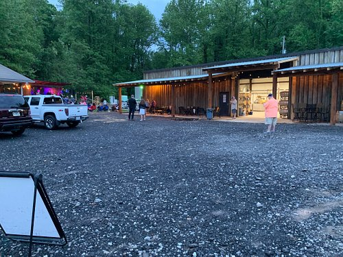 The center of our mountain village distillery is the 80 foot front porch, band stage and lawn. The grotto and fire pit areas are no slouch either.