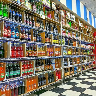 Over 250 varieties of glass bottled pop (soda) to choose from @ Grandpa Joe's Candy Shop!