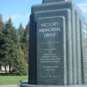 A closeup of the flagpole inscription