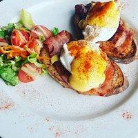 Eggs Benedict on homemade multigrain bread.