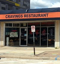 front of and entrance to Cravings Restaurant