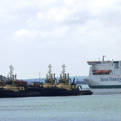 The Irish Ferry following the departing sea lane with the tugs berth in the foreground..