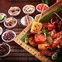 Bali Sea Voyage Grilled marinated lobster, prawn, fish fillet, clam, sweet corn, vegetable kebab potato and tomato