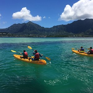 Kayaking in Kane'ohe Bay: calm waters, hidden patch reefs, and Ko'olau Mountain vistas.