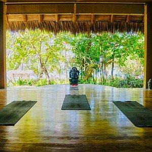 The open-air, beachfront yoga studio at our Costa Rica retreat