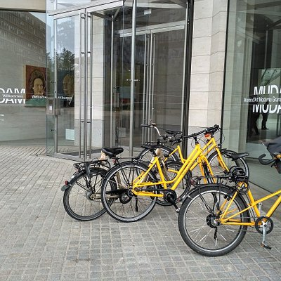 our new yellow bikes in front of the Museum of modern art