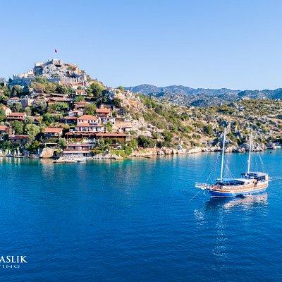 Luxury gulet Arkadaslik anchored in front of Simena castle (Kale) during a week-long Blue Cruise to the Kekova region.