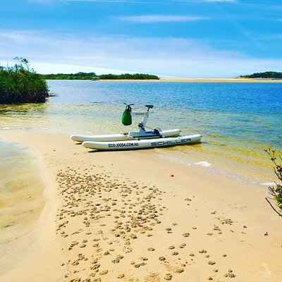 Use a water bike to discover the beauty of Noosa River. Pictured here pulled up on a sand bank near the river mouth, riders can enjoy a swim or picnic in their own secluded spot.