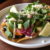 TOSTADA // Pulled Chicken, Refried Black Beans, Queso Fresco, Cilantro, Rainbow Radish, Lime Crema.