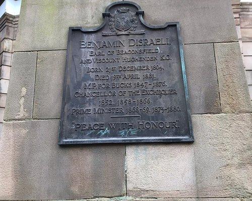 Statue of Disraeli and explanatory plaque