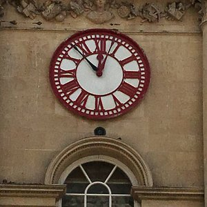 """Before you go into the """"flea market"""" in the old corn exchange - look up at the clock.  It has two minute hands.  It dates from a time when the railways had started to operate and local time was not working on timetables. The black hand shows Greenwich Mean time - the red one shows local Bristol time - which was a few minutes after London time"""
