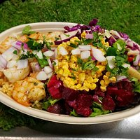 Our delicious Cilantro Lime Shrimp bowl with Mexican corn esquites, beat onion salsa, guacamole, and sprinkled with cilantro, onions, and jalapeno on a salad bowl with Spanish rice. This bowl is as healthy as it is colorful. Come try it out.
