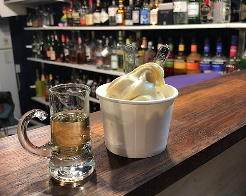 Homemade Bailey's ice cream with a butterscotch liqueur to pour on top