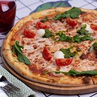 Pizza with mozzarella and pesto sause