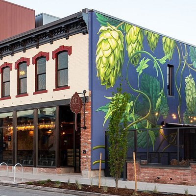 Early 1900's building, remodeled for use as a brewhouse and tasting room in 2018. Mural created by Mona Caron.