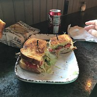 Sweet Turkey and Ham Sandwich with Kettle Chips and Dr. Brown soda.