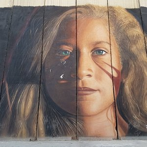 Ahed Tamimi portrait on the separation wall between Bethlehem and Jerusalem
