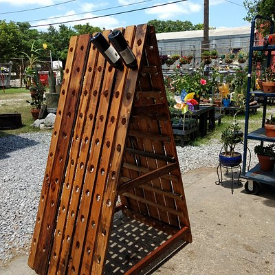 Custom Built Riddle Rack holds 140 bottles of wine. Backyard is filled with colorful finds for your yard!!!
