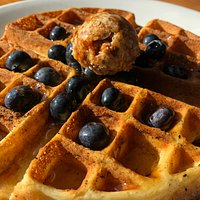 Our famous blueberry waffle, made from scratch to order, with caramelized honeycomb butter