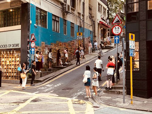 Tourists lining up to take pictures with our street art