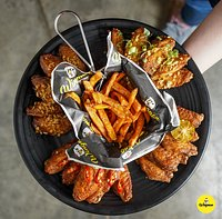 Wing platter- Singapore Zing, Thai Sweet Chilli, Carolina Reaper and Cajun flavours.