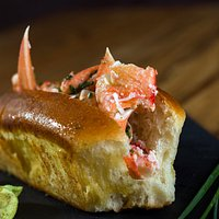 Original Lobster roll ... with warm butter toasted bread and our secret spices !