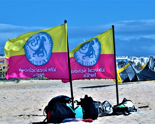 Tarifa camp by Kite Local School, sports school dedicated to water sports: kitesurf, windsurf and surf. In our kitesurf and surf courses everything is included  We also have brand new equipment that you can rent if you have an advanced level.  Our school is located in Tarifa main street: Batalla del Salado Nº 61, from there we will drive to the best spots depending on conditions. Holidays in south Spain, Tarifa (Cadiz), with our well-known school.