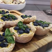 Lemon and blueberry tarts baked and prepared fresh daily.