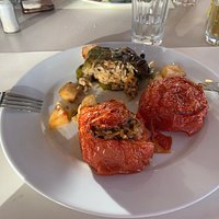 Stuffed tomatoes and peppers with rice and herbs