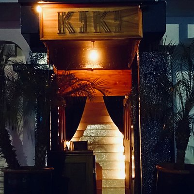 Outside of Kiki. Go in and up the stairs to find the bar and dancefloor!