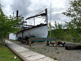 The front section of the S.S. Tutshi.  The back has been damaged by fire