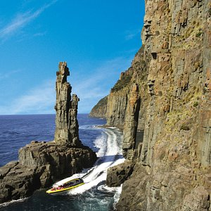 Pass through the narrow gap between the coast and 'The Monument', a tall slender stack.