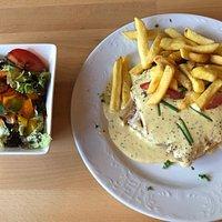 Dinner. Pork Schnizel (I think) with large basket of chips to share & a side salad. Excellent