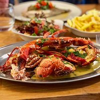 Whole lobster, simply cooked in garlic butter.