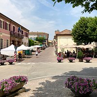 Barbaresco's main street and piazza as seen from the Enoteca Regionale del Barbaresco. Koki Wine Bar's patio on the right side at the end of the street.