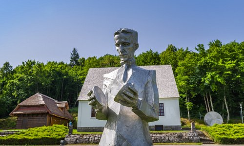 Statue of Nikola Tesla in front of his birth house