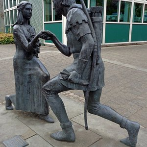 Robin & Marian statue in Edwinstowe high street opposite the library.