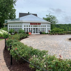 The entrance to the visitor center; a patch they give vets; first step to the distilling process;;one day fermentation tank; gorgeous grounds.