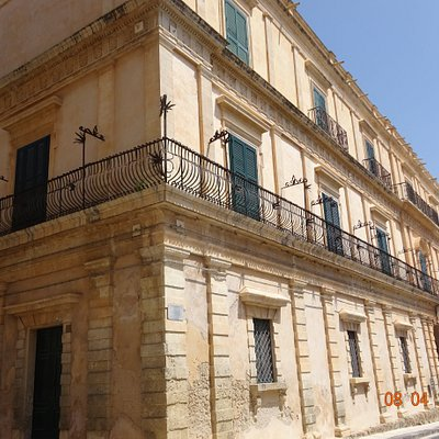 Palazzo Impellizzeri di San Giacomo is the most important building of the upper part of the city. The facade has a more sober look than most of the buildings in the center, blending the baroque with elegant decorative elements of neoclassical style - Noto, Sicily