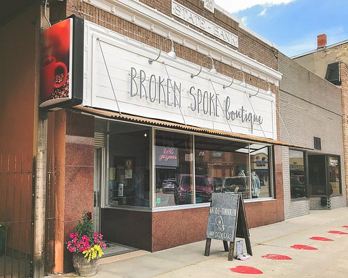 """The exterior of Broken Spoke Boutique, located in the fully remodeled and restored historic """"Nebraska State Bank"""" on Valentine, Nebraska's charming Main Street."""
