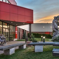 """The entrance at Grounds For Sculpture under a twilight sky, with Seward Johnson's monumental sculpture, """"King Lear"""" to herald your arrival."""