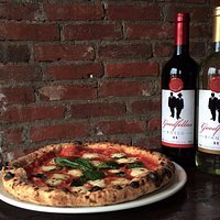 Our house branded wines pair beautifully with our Wood Oven Pizza.