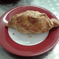 Vegetable and beef pasty with puff pastry and minced filling.