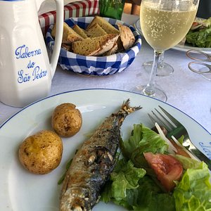Lunch of grilled sardines in Afurada on the bike route!