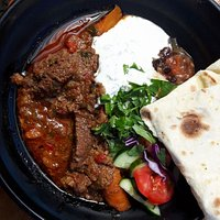 Our deep and deliscious beef curry! Hand made organic roti and backyard apple chutney.