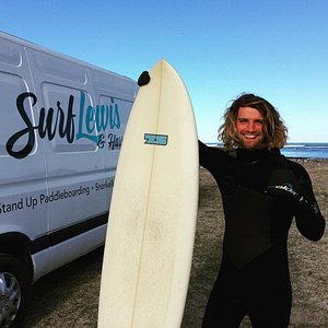 Connel our lead surf and SUP instructor going for a surf himself at a local beach.