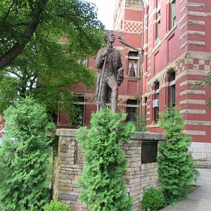 Statue of young Washington is located at the left corner looking in