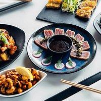 Tuna Tataki with Salsa Verde - Seared black pepper tuna served with salsa verde, fresh radish, and wasabi yuzu soy dressing. 8 pieces.