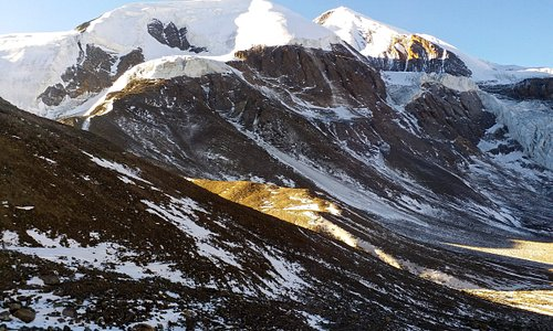 Scenic view of Thorong Ri (6144 m) seen during sunrise time after crossing Thorong La pass at an elevation of  ‎5416 m. You will be rewarded with magical Himalayan views, cross Highest Himalayan passe and reach Muktinath is included on day 8 of our Annapurna Circuit Trek available at : https://extolloadventures.com/annapurna-circuit-trek-14-days/ . Muktinath is the popular Vishnu temple located at the first highest altitude in the world (second is the Tungnath in India, 3680m) is a sacred place