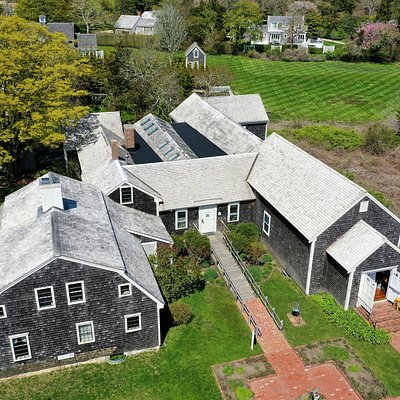 Aerial view of the Museum including the Old House, Mural Barn, and Main Galleries.  NIckerson North Beach Camp is to the left.